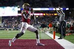 Boston College quarterback Anthony Brown celebrates his touchdown during the first half of an NCAA college football game against Miami in Boston, Friday, Oct. 26, 2018. (AP Photo/Michael Dwyer)