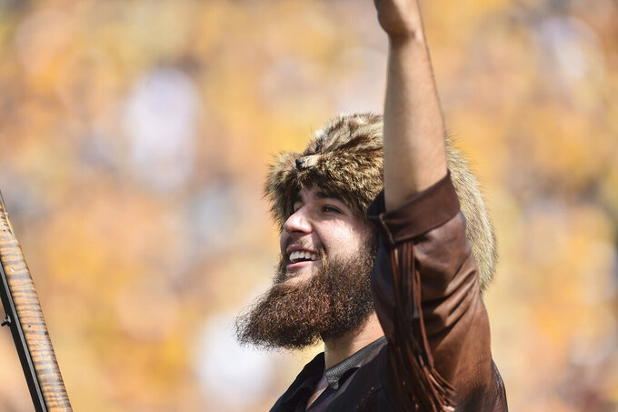 West Virginia Mountaineers mascot pumps up the crowd during the first half of an NCAA college football game against Virginia Tech in Morgantown, W.Va., Saturday, Sep. 18, 2021. (AP Photo/William Wotring)
