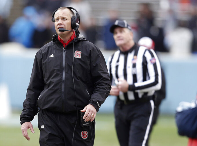 North Carolina State head coach Dave Doeren works the sidelines during the second half of an NCAA college football game against North Carolina in Chapel Hill, N.C., Saturday, Nov. 24, 2018. North Carolina State won 34-28 in overtime. (AP Photo/Gerry Broome)