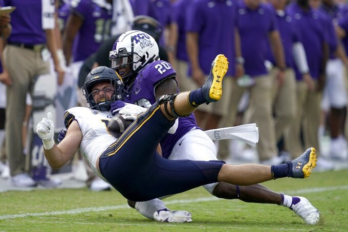 California tight end Collin Moore, bottom, is tackled after catching a pass by TCU safety La'Kendrick Van Zandt (20) in the second half of an NCAA college football game in Fort Worth, Texas, Saturday, Sept. 11, 2021. (AP Photo/Tony Gutierrez)