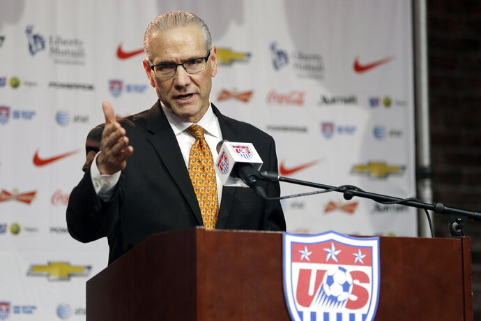 FILE - In this Nov. 13, 2015, file photo, U.S. Soccer Federation secretary general Dan Flynn speaks during a news conference in St. Louis. Flynn will retire as chief executive officer and secretary general of the U.S. Soccer Federation on Sept. 16. (AP Photo/Jeff Roberson, File)