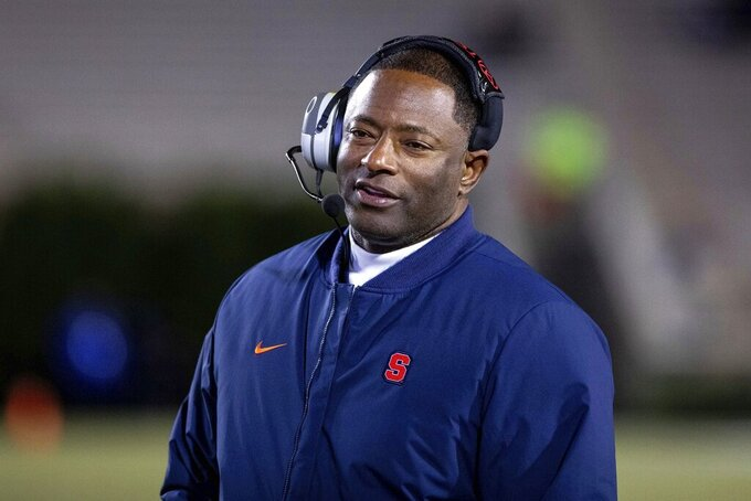 Syracuse Head Coach Dino Babers smiles on the sideline during an NCAA college football game against Duke in Durham, N.C., Saturday, Nov. 16, 2019. (AP Photo/Ben McKeown)