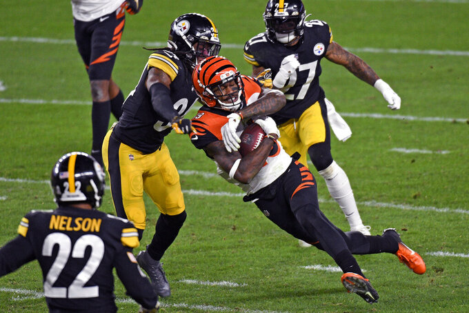 Cincinnati Bengals wide receiver Auden Tate (19) is tackled by Pittsburgh Steelers strong safety Terrell Edmunds (34) during the first half of an NFL football game in Pittsburgh, Sunday, Nov. 15, 2020. (AP Photo/Don Wright)