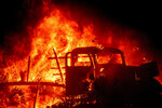 Flames consume a vintage truck as the Bond Fire burns through the Silverado community in Orange County, Calif., on Thursday, Dec. 3, 2020. (AP Photo/Noah Berger)