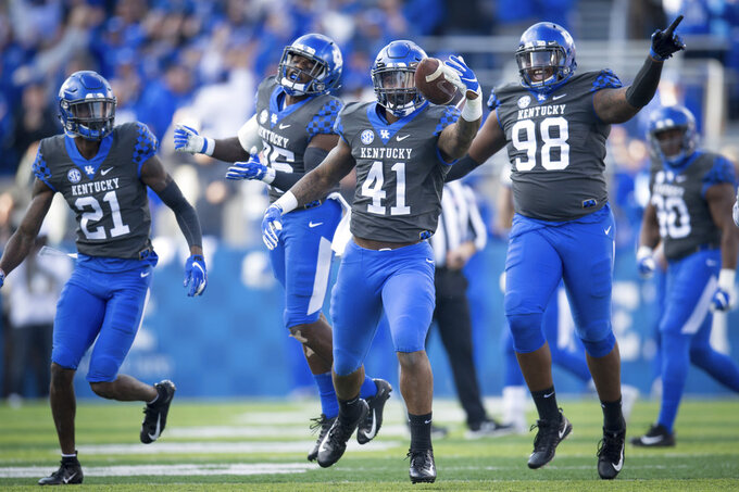 Kentucky linebacker Josh Allen (41) celebrate a turnover during the first half an NCAA college football game against Georgia in Lexington, Ky., Saturday, Nov. 3, 2018. (AP Photo/Bryan Woolston)