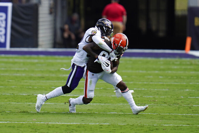 Baltimore Ravens safety DeShon Elliott (32) tackles Cleveland Browns wide receiver Jarvis Landry (80), during the first half of an NFL football game, Sunday, Sept. 13, 2020, in Baltimore, MD. (AP Photo/Julio Cortez)