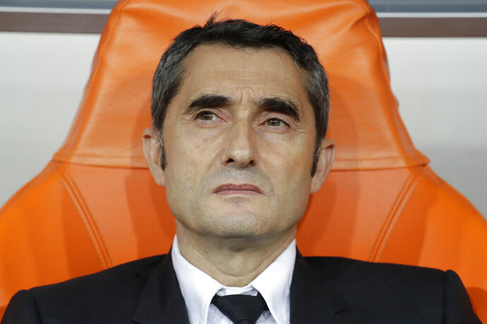 Barcelona's head coach Ernesto Valverde sits on the bench prior the Spanish Super Cup semifinal soccer match between Barcelona and Atletico Madrid at King Abdullah stadium in Jiddah, Saudi Arabia, Thursday, Jan. 9, 2020. (AP Photo/Hassan Ammar)