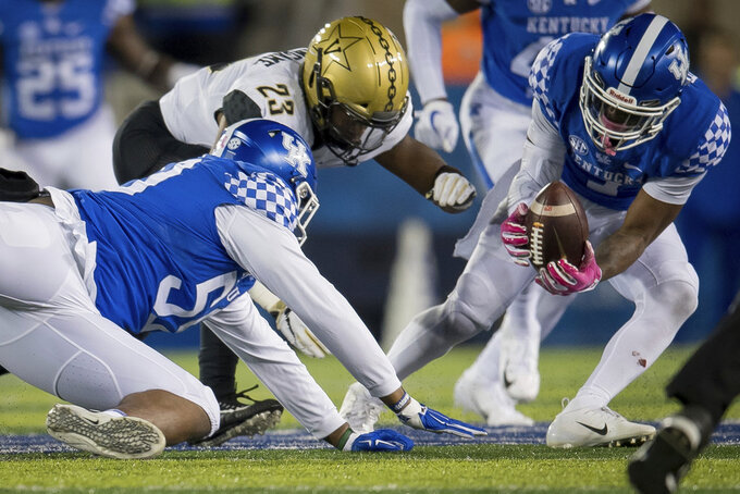 Kentucky safety Mike Edwards (7) recovers a fumble during the second half of an NCAA college football game against Vanderbilt in Lexington, Ky., Saturday, Oct. 20, 2018. (AP Photo/Bryan Woolston)
