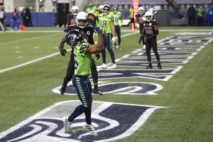 Seattle Seahawks wide receiver Tyler Lockett catches a pass for a touchdown against the Arizona Cardinals during the first half of an NFL football game, Thursday, Nov. 19, 2020, in Seattle. (AP Photo/Lindsey Wasson)