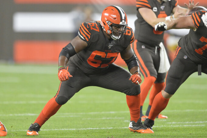 FILE - In this Sept. 22, 2019, file photo, Cleveland Browns guard Justin McCray (67) blocks during an NFL football game against the Los Angeles Rams in Cleveland.  Browns starting left offensive tackle Greg Robinson has been benched. It's likely that he will be replaced by Justin McCray, who has not started an NFL game at left tackle and has played their sparingly during his career. (AP Photo/David Richard, File)