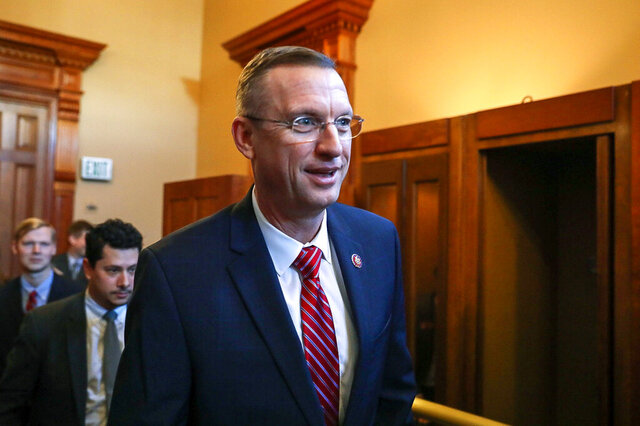 Georgia Rep. Doug Collins walks with colleagues at the state capitol in Atlanta, Tuesday, Jan. 28, 2020.  Collins announced that he's running for the U.S. Senate seat held by a fellow Republican, setting up a battle that could divide the state party this election year. Collins made the announcement Wednesday, Jan. 29, 2020 on Fox & Friends. (Riley Bunch/The Daily Times via AP)