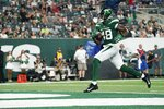 New York Jets' Kenny Yeboah scores a touchdown during the second half of an NFL preseason football game against the Philadelphia Eagles Friday, Aug. 27, 2021, in East Rutherford, N.J. (AP Photo/John Minchillo)