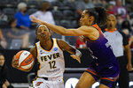 Indiana Fever guard Lindsay Allen (12) drives under Phoenix Mercury guard Skylar Diggins-Smith (4) in the second half of a WNBA basketball game in Indianapolis, Monday, Sept. 6, 2021. (AP Photo/Michael Conroy)