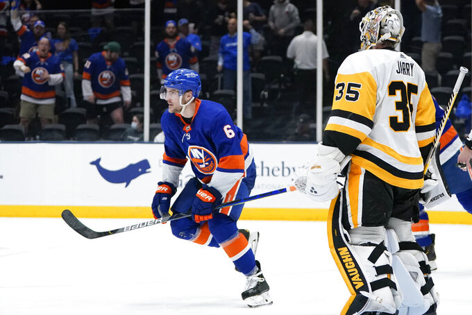 New York Islanders' Ryan Pulock (6) skates toward his bench after scoring a goal as Pittsburgh Penguins goaltender Tristan Jarry (35) watches him during the second period of Game 4 of an NHL hockey Stanley Cup first-round playoff series, Saturday, May 22, 2021, in Uniondale, N.Y. (AP Photo/Frank Franklin II)