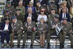 Polish war veterans wait before a memorial ceremony marking the 80th anniversary of the start of World War II in Warsaw, Poland, Sunday, Sept. 1, 2019. (AP Photo/Petr David Josek)