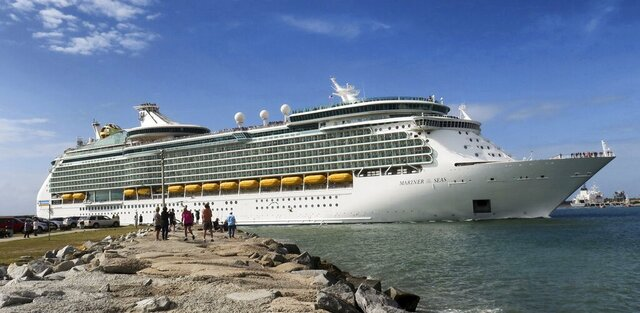 In this Monday, March 9, 2020 photo, Royal Caribbean's Mariner of the Seas departs Port Canaveral, Fla. On Friday, March 13, Royal Caribbean announced the suspension of all of their cruises worldwide for 30 days, in response to the coronavirus threat. (Joe Burbank/Orlando Sentinel via AP)