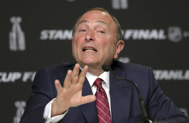 FILE - In this May 27, 2019, file photo, NHL Commissioner Gary Bettman speaks to the media before Game 1 of the NHL hockey Stanley Cup Finals between the St. Louis Blues and the Boston Bruins, in Boston. The NHL is one step closer to returning. Bettman unveiled a 24-team straight to playoffs format the league will use if it can clear the other hurdles to resume its season. Under the plan approved last week by players and agreed to by the NHL, the top four teams in each conference will play for seeding while the other 16 face off in best-of-five series to determine the field to vie for the Stanley Cup .(AP Photo/Charles Krupa, File)