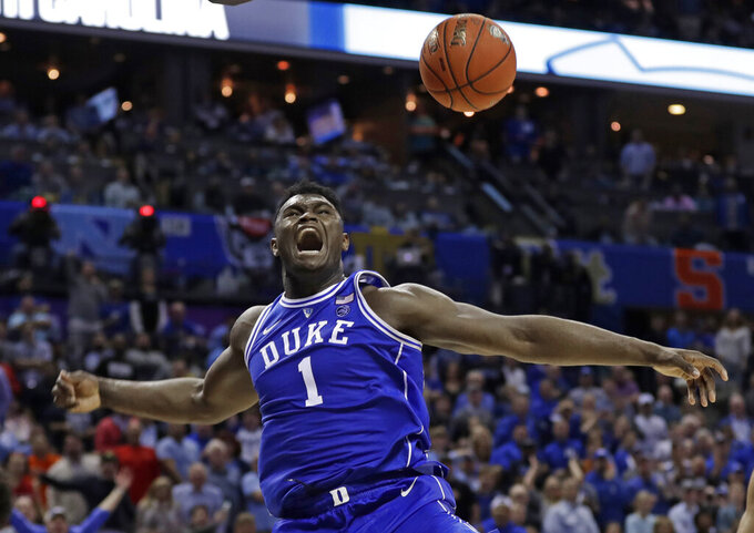 Duke's Zion Williamson (1) reacts after a dunk against North Carolina during the second half of an NCAA college basketball game in the Atlantic Coast Conference tournament in Charlotte, N.C., Friday, March 15, 2019. (AP Photo/Nell Redmond)