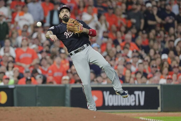 FILE - In this Tuesday, Oct. 29, 2019 file photo, Washington Nationals' Anthony Rendon throws out Houston Astros' George Springer during the third inning of Game 6 of the baseball World Series in Houston. Third baseman Anthony Rendon and the Los Angeles Angels agreed to a $245 million, seven-year contract a person with direct knowledge of the deal told The Associated Press, Wednesday, Dec. 11, 2019. (AP Photo/David J. Phillip, File)