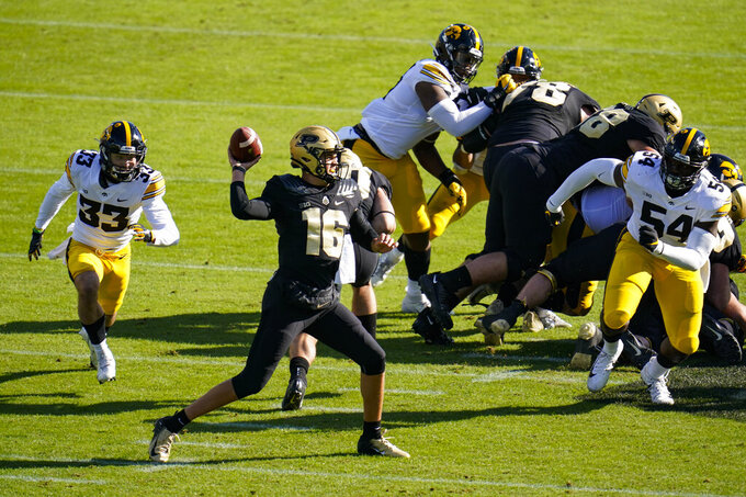 Purdue quarterback Aidan O'Connell (16) throws against Iowa during the first quarter of an NCAA college football game in West Lafayette, Ind., Saturday, Oct. 24, 2020. (AP Photo/Michael Conroy)