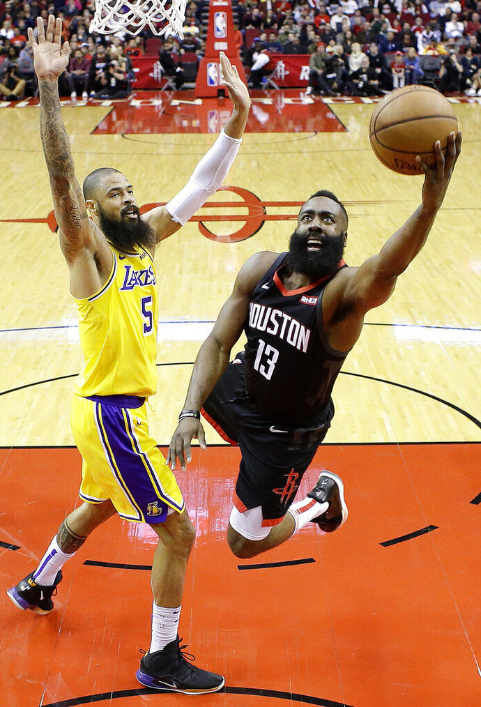 Houston Rockets guard James Harden (13) drives to the basket as Los Angeles Lakers center Tyson Chandler defends during the first half of an NBA basketball game, Saturday, Jan. 19, 2019, in Houston. (AP Photo/Eric Christian Smith)