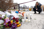 A woman gets emotional at the scene of a small memorial left in remembrance to Kobe Bryant at the entrance of the Bryant Gymnasium at Lower Merion High School, Monday, Jan. 27, 2020, in Wynnewood, Pa.  The 41-year-old Bryant and his 13-year-old daughter, Gianna, were among nine people who died in the crash in Calabasas in foggy weather conditions Sunday morning. (AP Photo/Chris Szagola)