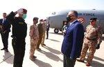 TAKES OUT REFERENCE TO DESIGNATE - Iraqi Prime Minister Mustafa al-Kahdimi, right, arrives to Mosul, Iraq, Wednesday, June 10, 2020. (Iraqi Prime Minister Media Office, via AP)