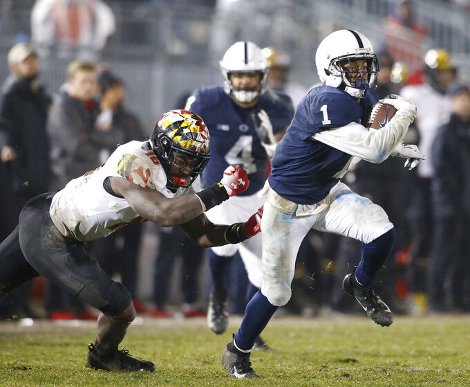 Penn State's KJ Hamler (1) gets past Maryland's Ayinde Eley (16) after a catch during the second half of an NCAA college football game in State College, Pa., Saturday, Nov. 24, 2018. Penn State won 38-3. (AP Photo/Chris Knight)