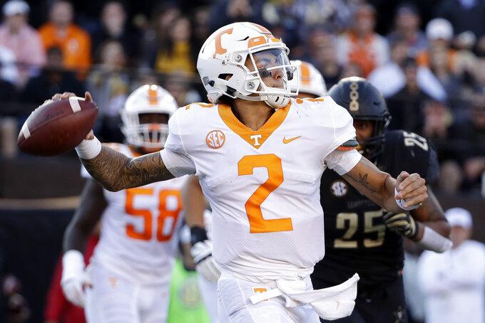 Tennessee quarterback Jarrett Guarantano passes against Vanderbilt in the first half of an NCAA college football game Saturday, Nov. 24, 2018, in Nashville, Tenn. (AP Photo/Mark Humphrey)