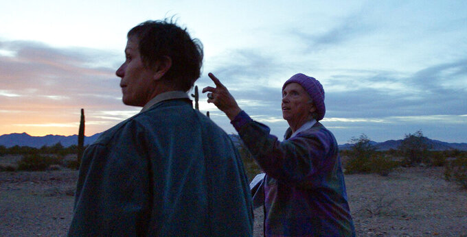 """Frances McDormand, left, and Swankie appear in a scene from """"Nomadland."""" (Searchlight Pictures via AP)"""