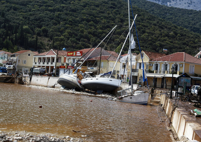 Yachts are pushed ashore following a storm at the village of Agia Efimia, on the Ionian island of Kefalonia, western Greece, Sunday, Sept. 20, 2020. A powerful tropical-like storm named Ianos, battered parts of central Greece and some of the western Ionian islands, as emergency workers rescued more than 600 people. (AP Photo/Nikiforos Stamenis)