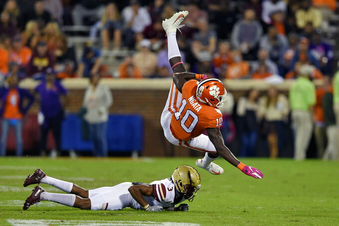 Clemson's Joseph Ngata (10) is tackled by Boston College's Jason Maitre during the first half of an NCAA college football game Saturday, Oct. 26, 2019, in Clemson, S.C. (AP Photo/Richard Shiro)
