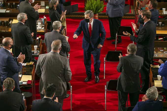North Carolina Gov. Roy Cooper leaves the House chamber after delivering his State of the State address before a joint session of the North Carolina House and Senate, Monday, April 26, 2021, in Raleigh, N.C. (Robert Willett/The News & Observer via AP)