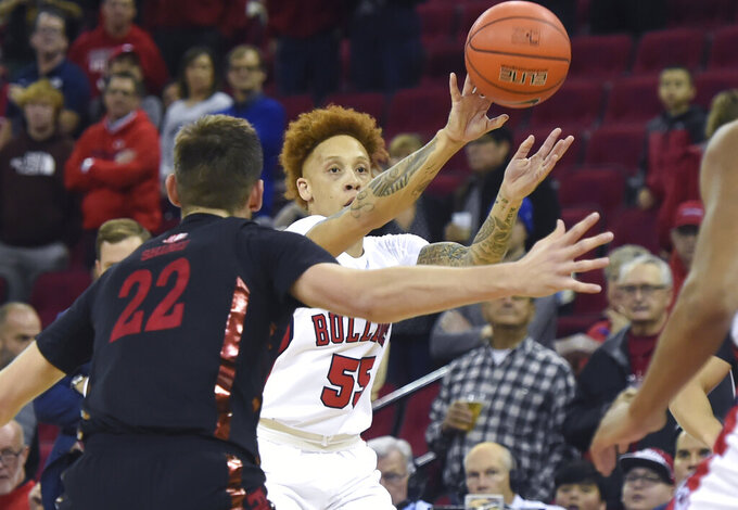 Fresno State's Noah Blackwell, right, passes the ball with UNLV's Vitaliy Shibel, left, defending during an NCAA college basketball game Wednesday, Dec. 4, 2019, in Fresno, Calif. (Eric Paul Zamora/The Fresno Bee via AP)