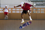 Nyjah Huston, from the United States, practices for the skateboarding competition in the 2020 Summer Olympics, Tuesday, July 20, 2021, at the Ariake Urban Sports Park in Tokyo. (AP Photo/Charlie Riedel)