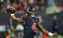 Houston Texans quarterback Deshaun Watson (4) throws against the New England Patriots during the first half of an NFL football game Sunday, Dec. 1, 2019, in Houston. (AP Photo/David J. Phillip)