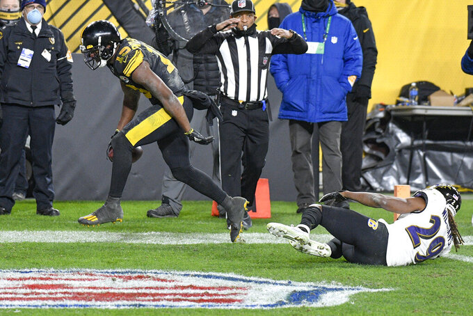 Pittsburgh Steelers wide receiver JuJu Smith-Schuster (19) celebrates after a touchdown catch next to Baltimore Ravens cornerback Tramon Williams during the second half of an NFL football game Wednesday, Dec. 2, 2020, in Pittsburgh. (AP Photo/Don Wright)