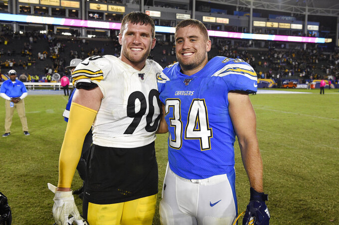 Pittsburgh Steelers outside linebacker T.J. Watt, left, and Los Angeles Chargers fullback Derek Watt pose together after an NFL football game, Sunday, Oct. 13, 2019, in Carson, Calif. (AP Photo/Kelvin Kuo)