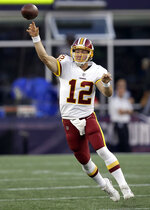 Washington Redskins quarterback Colt McCoy passes against the New England Patriots during the first half of a preseason NFL football game, Thursday, Aug. 9, 2018, in Foxborough, Mass. (AP Photo/Charles Krupa)