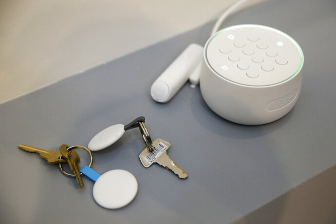 FILE- In this Sept. 20, 2017, file photo the Nest Secure alarm system is seen on display during an event in San Francisco. Google says it forgot to mention that it included a microphone in the security product it began selling in 2017, but blames the omission on an error. When the company's Nest Secure home alarm system hit the market, its product information didn't mention a microphone. Google said in a statement that the microphone wasn't intended to be a secret and should have been disclosed.  (AP Photo/Eric Risberg, File)