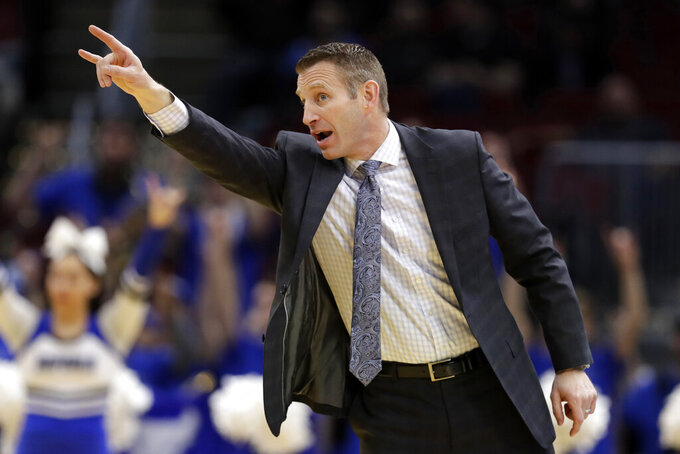 FILE - In this Thursday, March 14, 2019, file photo, Buffalo head coach Nate Oats yells instruction to players during the first half of an NCAA college basketball game against Akron at the Mid-American Conference tournament in Cleveland. Buffalo showing signs of shedding college basketball's mid-major label in preparing to make fourth NCAA Tournament appearance in five years.  (AP Photo/Tony Dejak, File)
