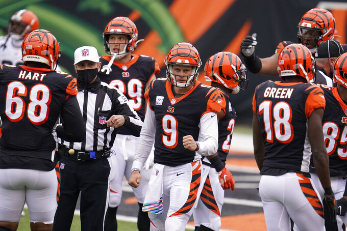 Cincinnati Bengals quarterback Joe Burrow (9) reacts during the first half of an NFL football game against the Cleveland Browns, Sunday, Oct. 25, 2020, in Cincinnati. (AP Photo/Michael Conroy)