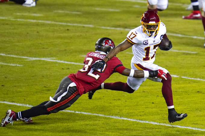 Washington Football Team wide receiver Terry McLaurin (17) runs with the ball against Tampa Bay Buccaneers safety Mike Edwards (32) during the first half of an NFL wild-card playoff football game Saturday, Jan. 9, 2021, in Landover, Md. (AP Photo/Julio Cortez)