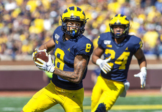 Michigan wide receiver Ronnie Bell (8) rushes after a reception for a first down in the second overtime period of an NCAA football game against Army in Ann Arbor, Mich., Saturday, Sept. 7, 2019. Michigan won 24-21 in double-overtime. (AP Photo/Tony Ding)