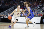 Northern Iowa's AJ Green (4) drives past Drake's Noah Thomas during the second half of an NCAA college basketball game in the quarterfinal round of the Missouri Valley Conference men's tournament Friday, March 6, 2020, in St. Louis. (AP Photo/Jeff Roberson)