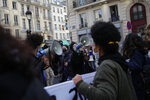 Students demonstrate Wednesday, Jan. 20, 2021 in Paris. French university students protested on Paris' Left Bank to demand to be allowed back to class, and to call attention to suicides and financial troubles among students cut off from friends, professors and job opportunities amid the pandemic. (AP Photo/Christophe Ena)