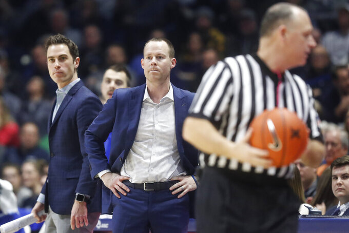 Xavier head coach Travis Steele reacts after receiving a technical foul in the second half of an NCAA college basketball game against Marquette, Saturday, Jan. 26, 2019, in Cincinnati. (AP Photo/John Minchillo)