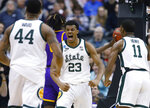 Michigan State forward Xavier Tillman (23) turns to looks at teammates Nick Ward (44) and Aaron Henry (11) after scoring against LSU during the first half of an East Regional semifinal in the NCAA men's college basketball tournament in Washington, Friday, March 29, 2019. (AP Photo/Patrick Semansky)