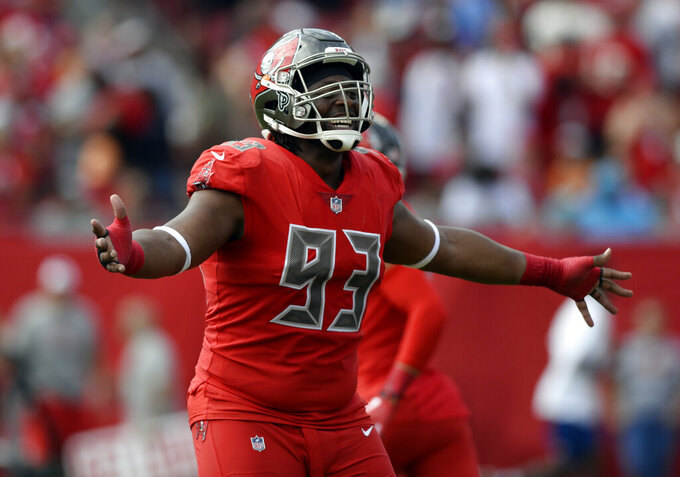 FILE - In this Dec. 2, 2018, file photo ,Tampa Bay Buccaneers defensive tackle Gerald McCoy (93) celebrates an interception by defensive back Andrew Adams during the first half of an NFL football game against the Carolina Panthers in Tampa, Fla. Free agent defensive tackle Gerald McCoy will visit the Cleveland Browns, who hope to sign the six-time Pro Bowler. General manager John Dorsey said Thursday, May 23, 2019, that McCoy, who was released earlier this week in a cost-cutting move, will be at the team's facility Friday. (AP Photo/Jason Behnken, File)