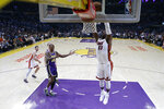 Miami Heat's Bam Adebayo (13) dunks past Los Angeles Lakers' Dwight Howard (39) during the first half of an NBA basketball game Friday, Nov. 8, 2019, in Los Angeles. (AP Photo/Marcio Jose Sanchez )